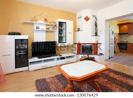 Beautiful living room with fireplace - stock photo