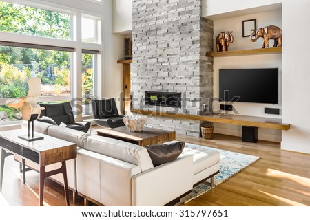 Beautiful living room with hardwood floors and fireplace in new luxury home. Focus is on Foreground  - stock photo