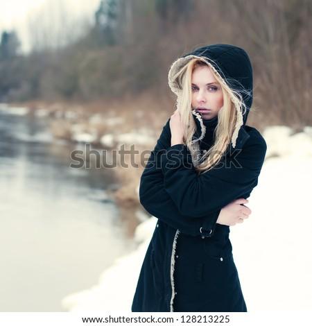 beautiful lonely girl sad winter near water - stock photo