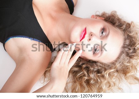 beautiful long blond curly hair of young attractive woman to lie