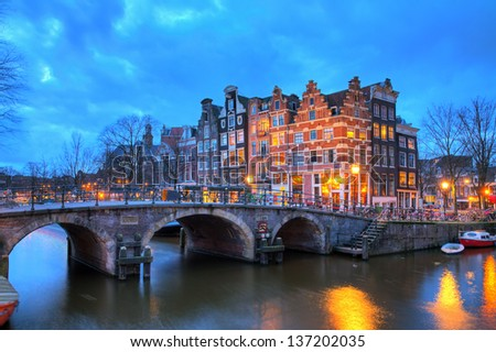 Beautiful long exposure HDR image of the Brouwersgracht in Amsterdam, the Netherlands, a UNESCO world heritage site. - stock photo