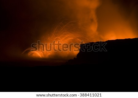beautiful long exposure image of lava eruption, near Kalapana, Hawaiis Big Island  - stock photo