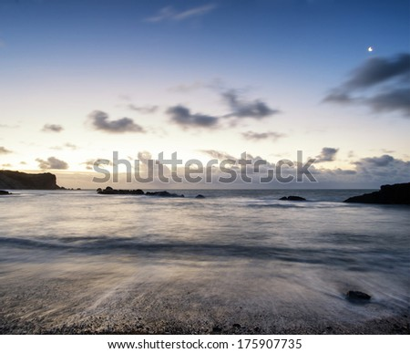 Beautiful long exposure landscape of beach at sunrise