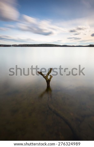 Beautiful long exposure landscape of lake in Mazury lake district (Krzywe lake near Olsztyn).