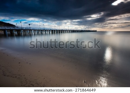 Beautiful long exposure seascape with wooden pier. Pier in Orlowo, Gdynia in Poland.