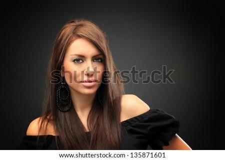 beautiful long hair brunette woman portrait, studio shot - stock photo