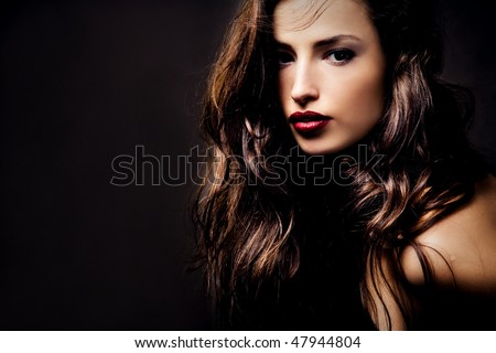 beautiful long hair brunette woman portrait, studio shot - stock photo