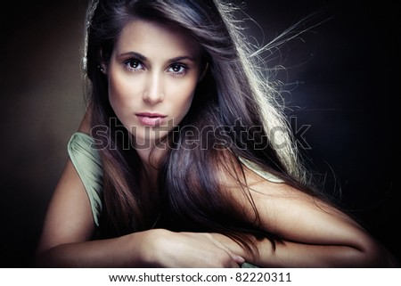 beautiful long hair brunette woman,  small amount of grain added, studio shot