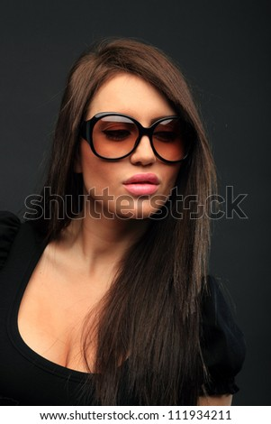 beautiful long hair brunette woman wearing sunglasses portrait, studio shot