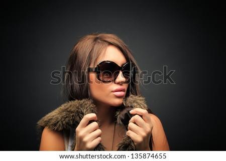 beautiful long hair brunette woman wearing sunglasses portrait, studio shot - stock photo