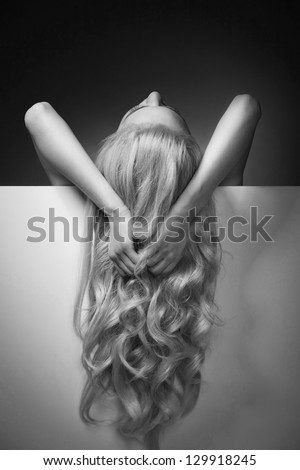 Beautiful Long Hair on an Attractive Woman over white board - stock photo