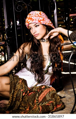 beautiful long hair woman in oriental clothes, outdoor shot - stock photo