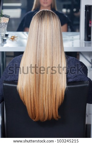 Beautiful long hair. Woman in salon - stock photo