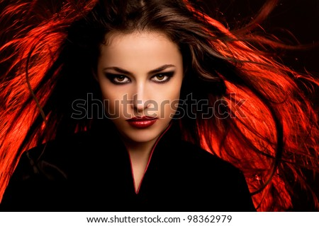 beautiful long hair young woman portrait with dark makeup, studio - stock photo