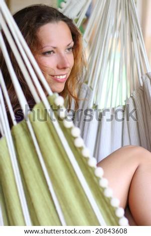 beautiful long-haired girl relaxing in hammock - stock photo