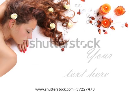 beautiful long-haired girl relaxing in spa salon - stock photo
