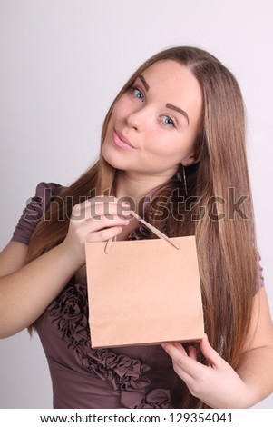 Beautiful long-haired girl with shopping bags