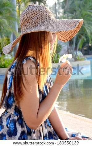 Beautiful long hairs lady in long dress and big beach hat on her morning relax vacation.