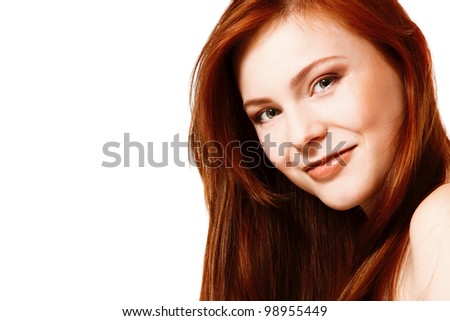 Beautiful long red health hair of young attractive woman. Isolated on white background