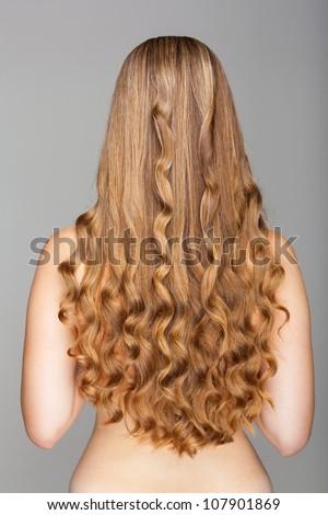 Beautiful long wavy hair. Back view - stock photo