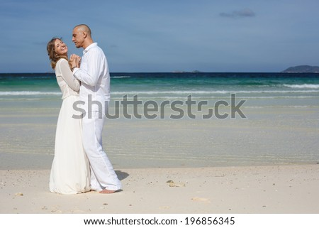 Beautiful love couple on the beach