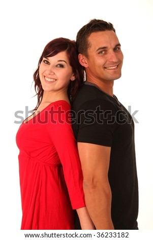 Beautiful love couple standing back to back and smiling