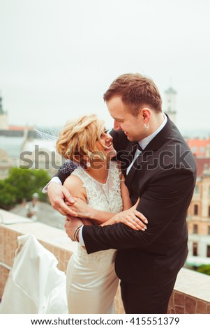 beautiful lovely couple looking into each other's eyes - stock photo