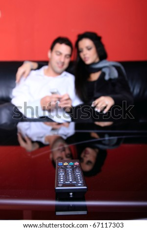Beautiful loving couple at home watching tv selective focus