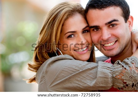 Beautiful loving couple hugging and having fun - stock photo