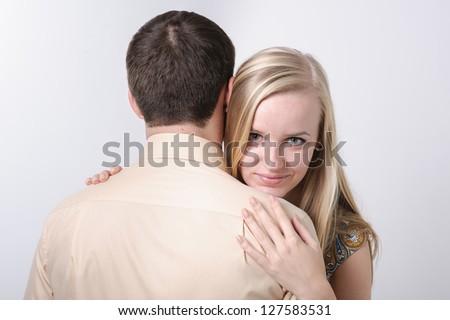 Beautiful loving couple hugging and having fun. Happy Couple in Love - stock photo