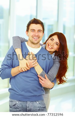 Beautiful loving couple hugging and looking happy - stock photo