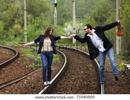 Beautiful loving couple walking outdoor - stock photo
