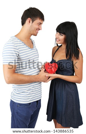 Beautiful loving couple with gift isolated on white