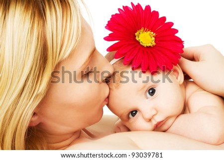 beautiful loving mother kissing baby girl, mother's love on white - stock photo