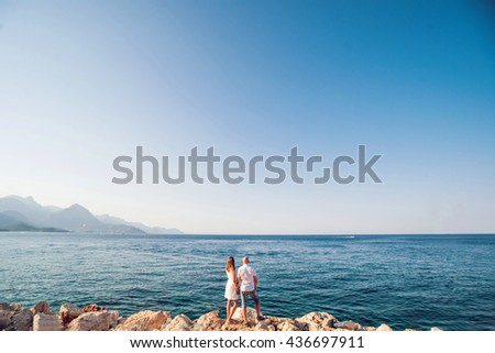 Beautiful loving young couple. Sea and sky. Background