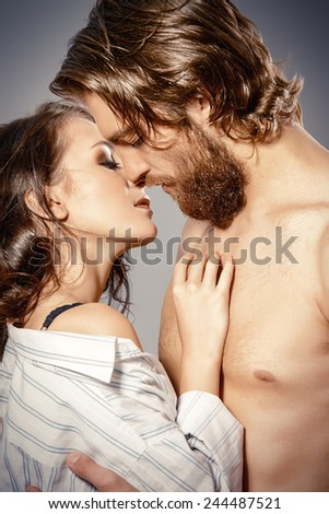 Beautiful loving young people kissing. Passion. Love concept.
