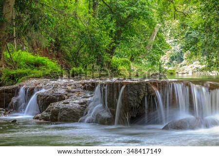 Beautiful Lush Waterfall in Thailand - stock photo