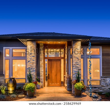 Beautiful Luxury Home Exterior at Night with Deep Blue Sky - stock photo