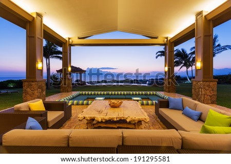 beautiful luxury home exterior patio lounge at sunset - Luxury House Exterior
