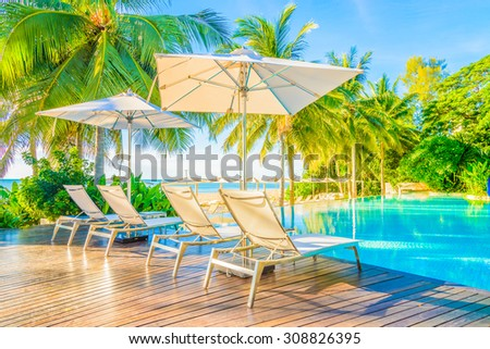 Beautiful luxury hotel pool resort nearly beach - Bright light processing style