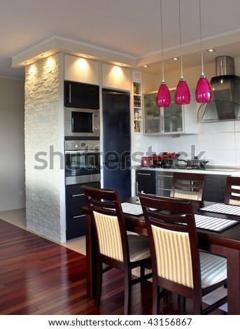 Beautiful, luxury modern kitchen with exotic wood on the floor - stock photo