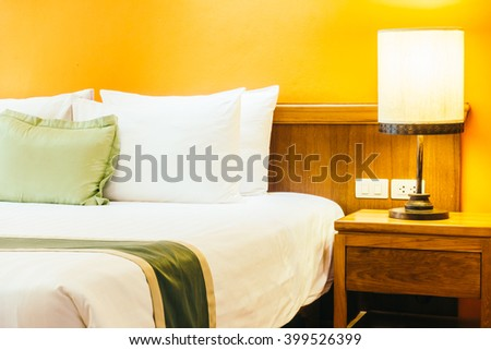 Beautiful luxury Pillow on bed with light lamp decoration in bedroom interior - Vintage Light Filter