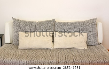 Beautiful luxury pillow on sofa decoration in living room interior - stock photo