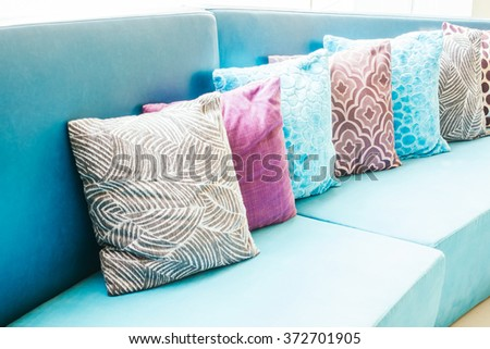 Beautiful luxury pillow on sofa decoration in livingroom interior - Light Vintage Filter - stock photo
