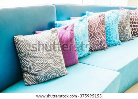 Beautiful luxury pillow on sofa decoration in livingroom interior - Light Vintage Filter