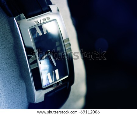 Beautiful luxury platinum watch in store. Extreme close-up, great dof. - stock photo