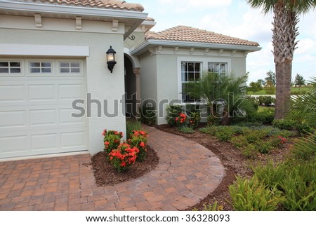 Beautiful Luxury tropical model home - stock photo