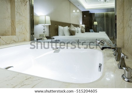 Beautiful luxury white bathtub decoration in bathroom interior