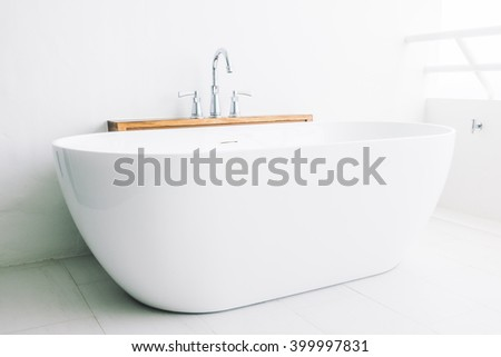 Beautiful luxury white modern bathtub decoration in bathroom interior - Filter effect - stock photo