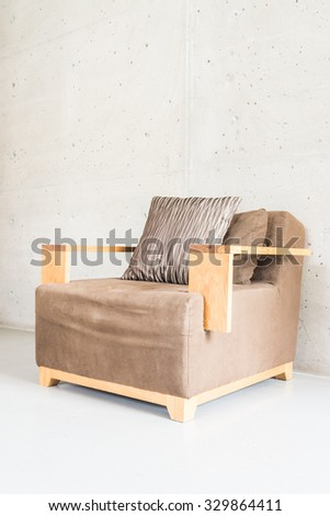 Beautiful luxury wooden sofa decoration on empty wall with vase plant